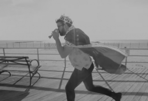 "Video still from ""King Of The World"""
