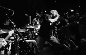 "Milo and Co. rock out to a crowd of zombies in the ""Victim Of Me"" music video."